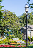Lamp Post by Bench in Garden Stock Image