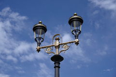 Lamp post and blue sky in background Royalty Free Stock Image