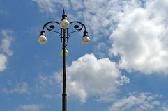 Lamp post. Background with blue sky and fluffy clouds Royalty Free Stock Photography