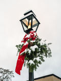 Lamp post with Christmas decoration Royalty Free Stock Photo