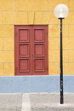 Lamp post and colorful door Stock Photography