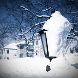 Lamp post covered with snow Stock Photos