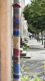 Lamp post covered in wool fabrics Royalty Free Stock Photo