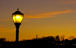 A lamp post in dusk with space for text. Sunset colors Stock Photography