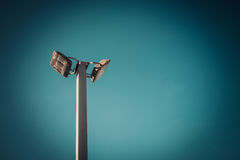 Lamp post electricity industry with blue sky background. Spotlig Royalty Free Stock Photo