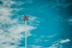 Lamp post electricity industry with blue sky background. Spotlig Royalty Free Stock Photography