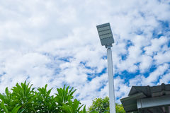 Lamp post electricity industry with blue sky background and tree. Spotlight tower against blue sky. street lamp. modern light pole stock photo