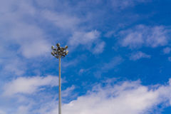 Lamp post electricity industry with blue sky. Spotlight tower. Stock Photos