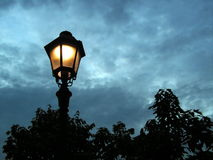 Lamp post in the evening royalty free stock image
