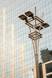 Lamp post in front of a Glass and concrete facade on a modern corporate skycraper building in Brazil Stock Photo