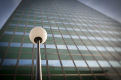 Lamp post in front office building facade Stock Photography
