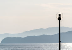 Lamp post and island. Royalty Free Stock Photos