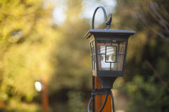 Lamp post and light. Sun setting over a wooden deck on an autumn Royalty Free Stock Images