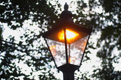 Lamp post lit during day stock photos