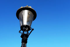Lamp Post In London. A lamp post by the river Thames in London Stock Photo