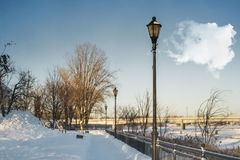 Lamp post on Promenade beside a river. The City of St. Eustache in Quebec, Canada is best known for its historical heritage and architectural heritage.Beautiful Royalty Free Stock Photography