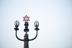 Lamp post with religios symbol. Stock Photography