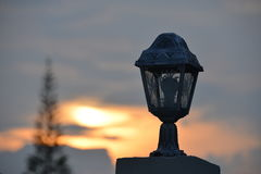 Lamp post silhouette. Have background is sunset Royalty Free Stock Photos