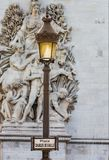 Lamp post stands before The Arc de Triomphe on the Place de Charles De Gaulle-Paris France Royalty Free Stock Image
