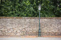Lamp post street on brick wall background Royalty Free Stock Images
