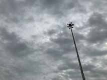Lamp post or street light with rain cloud coming in sky before storm for background stock image