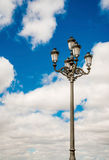 Lamp Post Street Road over blue sky. Royalty Free Stock Image