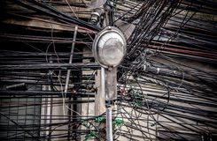 Lamp post on tangle of electrical Wires background Royalty Free Stock Image