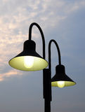 Lamp post in the twilight Stock Images