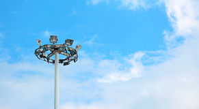Lamp post under clouds Stock Images