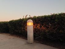 Lamp Post on the walkway. Is glowing brightly Stock Photo