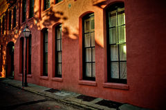 Lamp Post and Windows on a Side Street in Charleston South Carolina. Photographed in late afternoon light stock photo