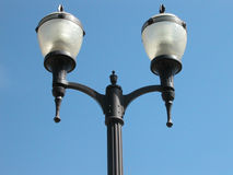 Lamp Posts against Blue Sky Stock Image