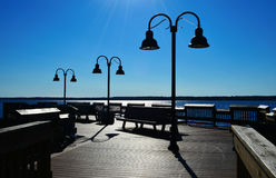 Lamp Posts. On boardwalk deck on Lake Michigan in Gladstone, Michigan in the beautiful morning light with blue skies Royalty Free Stock Image