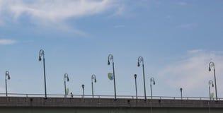 Lamp posts, bridge, guy Stock Photos