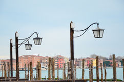 Lamp-posts on the Grand Canal on a quiet day of spring, Venice, Italy Stock Photos