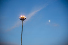 Lamp posts and moon. In Thailand Royalty Free Stock Photos