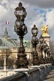 Lamp posts in Paris. Row of lamp posts on Alexander lll bridge in Paris, France Stock Image