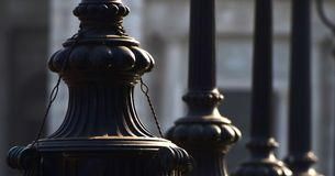 Lamp posts stack stock photograph. The beautiful lower parts of some of the antique lamp posts object background photograph stock images
