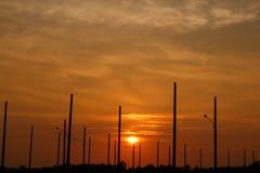 Lamp Posts on Sunset background Stock Image
