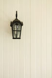 Lamp posts. Black Lamp posts on the wall royalty free stock photo