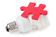 Lamp and puzzle Stock Photography