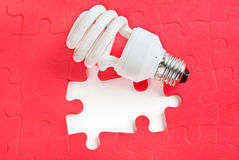Lamp and puzzle Royalty Free Stock Images