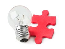 Lamp and puzzle Stock Images