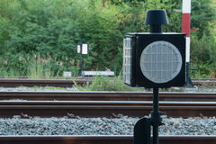 Lamp-railroad  and railroad station Stock Photography
