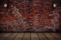 The lamp on the red brick walls and old wooden floors. Royalty Free Stock Images
