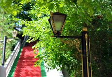 lamp beside the red stairs Stock Photos