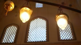 Lamp religion church. Lamp with a burning candle dark stock video footage