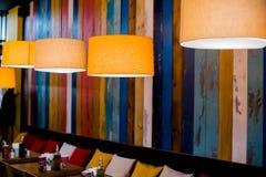 Lamp in the restaurant. Orange warm light.Vintage interior lighting lamp for cafe decor, interior details. Lamp in the restaurant.Vintage interior lighting lamp stock photography