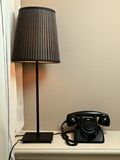 Lamp and retro telephone Stock Photography