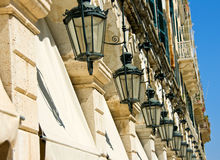 Lamp Row. A row of lamps in Corfu town royalty free stock photography